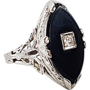 18kt White Gold Ring set with Black Onyx and a Single European cut Diamond, Circa 1915