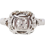 Retro 18 Karat White Gold Ring set with Round Transition cut Diamond, Circa 1940
