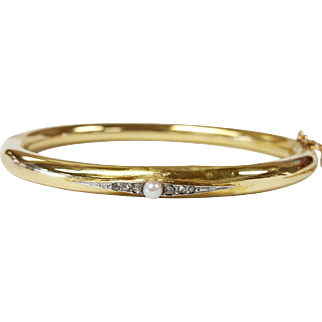 18kt Gold and Platinum Bangle Bracelet set with a Cultured Pearl and Diamonds