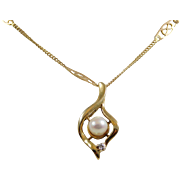 Ladies 14 karat Rose Gold Designer Chain with 10 karat Yellow Gold Pearl Pendant