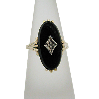 Beautiful Vintage Prong Set Black Onyx Ring with a Center Diamond in 10k YG