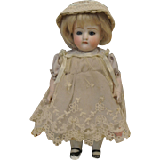 "Darling 8"" All Bisque-Glass Eyes with Painted Socks and Shoes"
