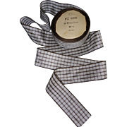 Pretty French ribbon checkered brown to ivory background.