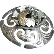 Vintage brooch in silver and gold Celtic style or viking