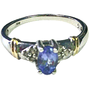 Tanzanite Ring with Diamonds and a unique 10K White Gold Band with yellow Gold Accents