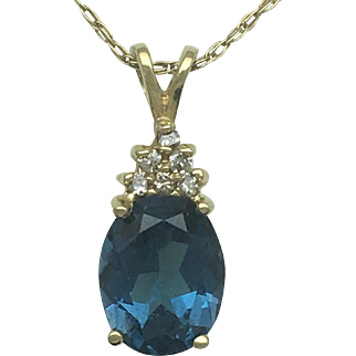 London Blue Topaz and Diamond pendant in 14K with chain