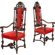 Pair of Flemish figural carved high back arm chairs