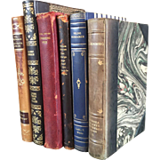 A set of 6 antique leather bound books.