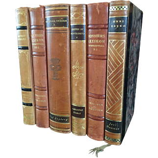 A set of 6 antique leather bound decorative books.