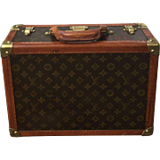 "A lovely small size vintage Louis Vuitton suitcase 16"" in length."