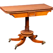A 19th century English Regency games table in Satinwood.