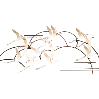 A contemporary metal wall hanging sculpture of birds in flight by Curtis Jere.