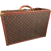 A Vintage Louis Vuitton suitcase.
