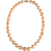 Pink / Peach Colored Graduated Baroque Pearl Strand with Sterling Silver Clasp - Cultured Freshwater Pearls