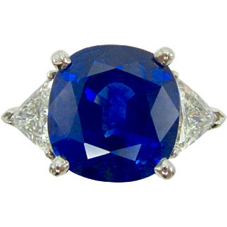 6.03 ct Blue Sapphire, 1 ctw Trilliant Cut Diamond, & Platinum Three Stone Engagement Ring