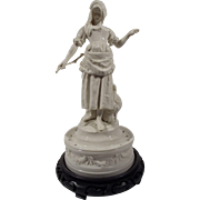 """Peasant Girl on a Swagged Pedestal"", Porcelain Figurine with Wooden Base"