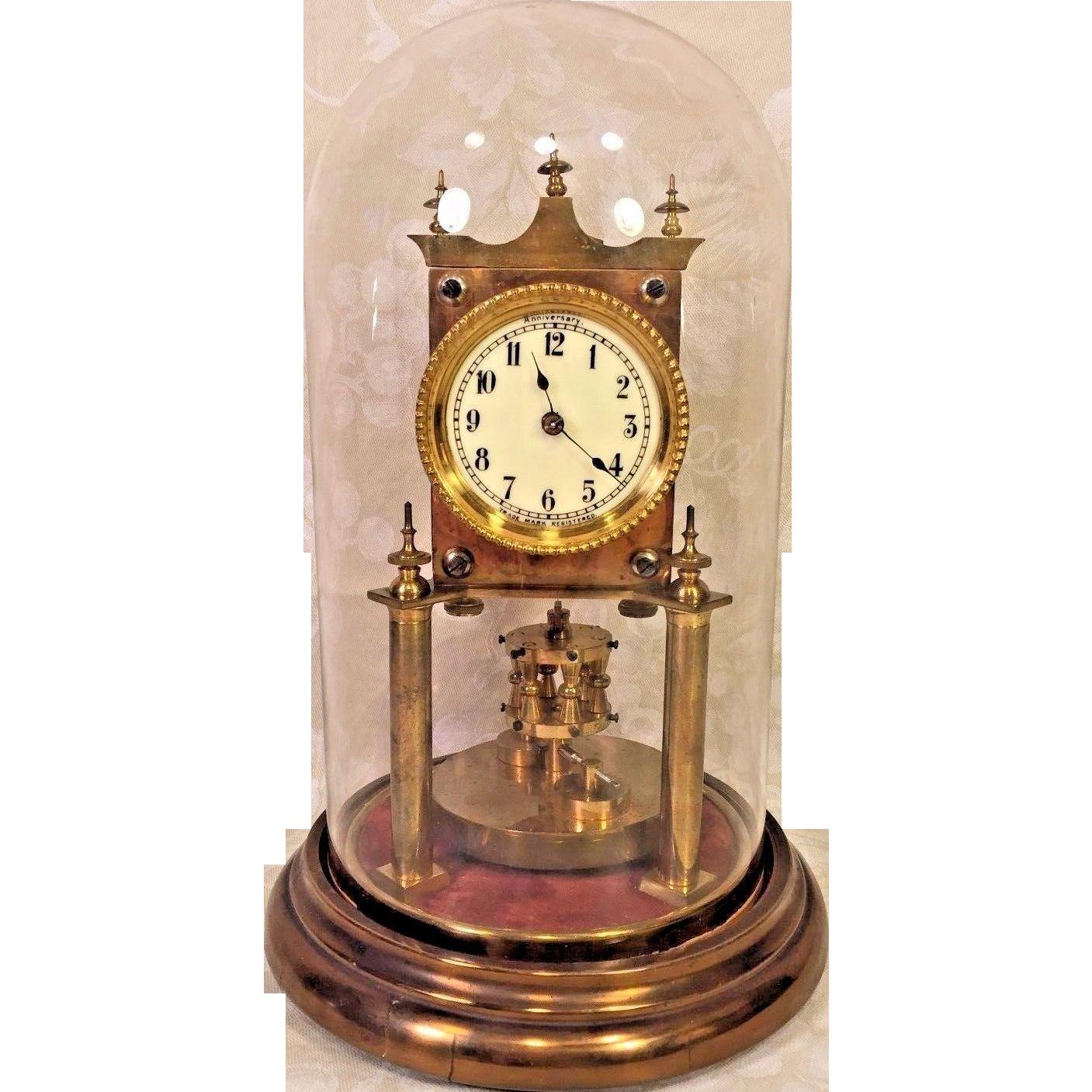 torsion pendulum clock. antique german 400 day clock torsion pendulum running nice glass dome porcelain face 1920s a