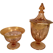 Two Pink Glass Pieces with Gold Colored Trim with Design Bowl Vase with Lid