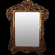 19th century heavily carved Italian Baroque gilt mirror
