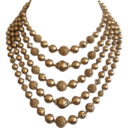 Stunning 5 Strand Gold Bead Necklace