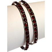 Fabulous antique matched pair of bohemian garnet sterling bangle bracelets