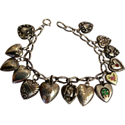 Antique sterling charm bracelet and 14 sterling puffy hearts - enamel, Indian, floral, etc.