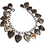 Beautiful vintage sterling puffy hearts charms bracelet - some enamel, lampl