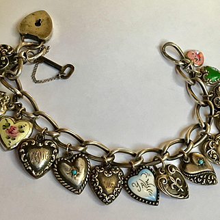 Antique sterling puffy heart charms bracelet - 15 hearts 1 lock with key