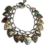 Antique sterling puffy hearts charm bracelet - some enamel