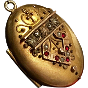 Antique gold filled Victorian locket with tiny garnets