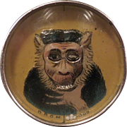 Dexterity Puzzle Monkey with rolling eyes clutching throat  circa 1900 German
