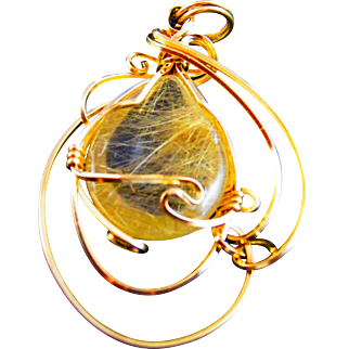 A unique handcrafted pendant with semi precious stone.