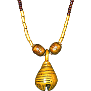 Vintage African beaded with glass beads and a small bell on the bottom.