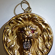 10kyg Lion locket with old mine cut diamond  c. 1890