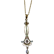 Art Nouveau pearl, enamel and old mine cut diamond pendant c.1910