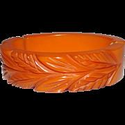 Great Hinged & Deeply Carved Honey Orange Bakelite Bracelet