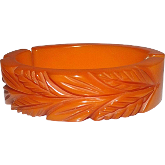 Great Hinged & Deeply Carved Honey Orange Bakelite Bracelet