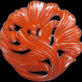 Large Deeply Carved Pumpkin Colored Bakelite Flower Brooch