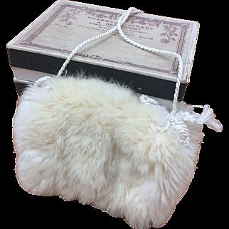 Charming fur muff in box