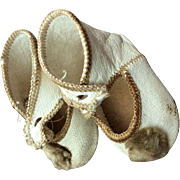 Old cream leather shoes for bebe