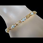 Gold Overlay Sterling Silver Aquamarine & CZ Tennis Bracelet