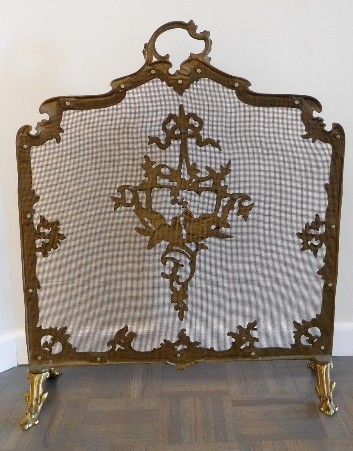 antique footed ormolu fireplace screen with bird accents from the
