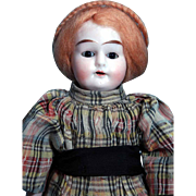 """Alma bisque head 11"""" tall doll with brown stationary eyes, open mouth with teeth and strawberry blonde mohair wig on cloth body. Alma 18/0 Germany"""