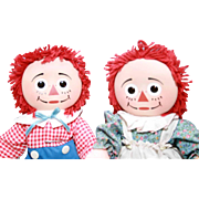 """Pair of Raggedy Ann and Raggedy Andy dolls 13"""" tall with ceramic heads and cloth bodies, Knickerbocker."""