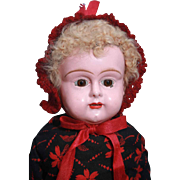 """Metal head doll with caracal lambs wool wig in blonde color that is 15"""" tall, unmarked and untagged."""