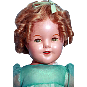 """Shirley Temple composition doll 18"""" marked 'Shirley Temple Ideal Cop N & T Co. untagged replaced mohair wig and replaced clothes. - Red Tag Sale Item"""