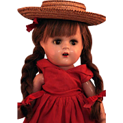 """Madame Alexander Elizabeth face composition doll 13"""" tall in tagged red dress in very good condition."""