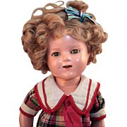 """Shirley Temple 16"""" composition doll by Ideal with markings and in tagged Bright Eyes dress in good condition."""