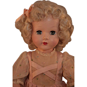 "Honey hard plastic doll marked Effanbee, 19"" tall in original dress, good condition, 1949-1955."
