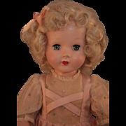 "Honey hard plastic doll marked Effanbee, 19"" tall in original dress, good condition, 1949-1955."
